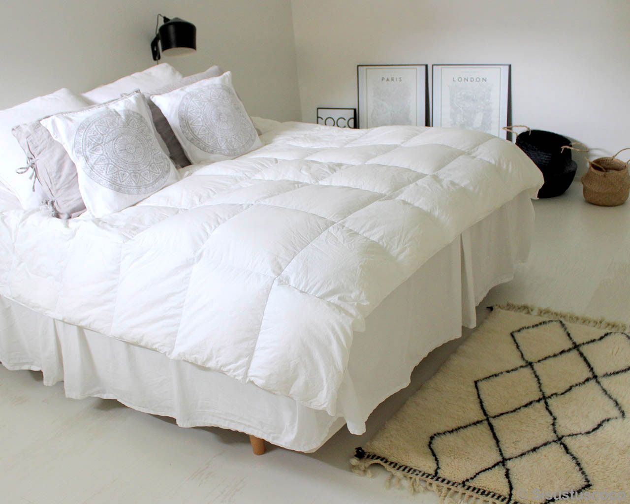 nice bed with multiple pillows moroccan cream color rugs