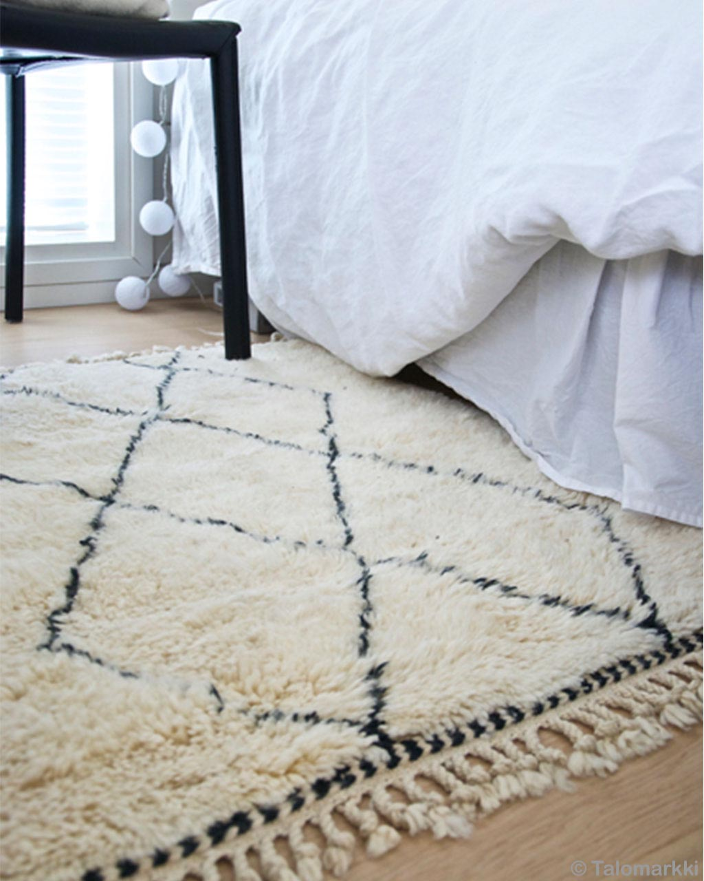 white ball shape bulbs and chair legs made by moroccan modern rug store