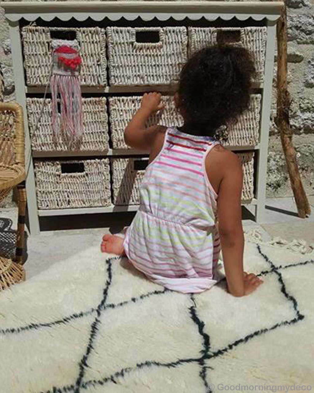 woolen girl looking for something in cabinet moroccan contemporary kitchen rugs