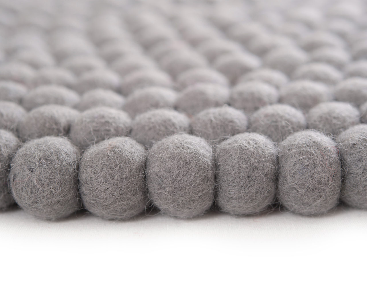 grey felted ball rugs sukhi