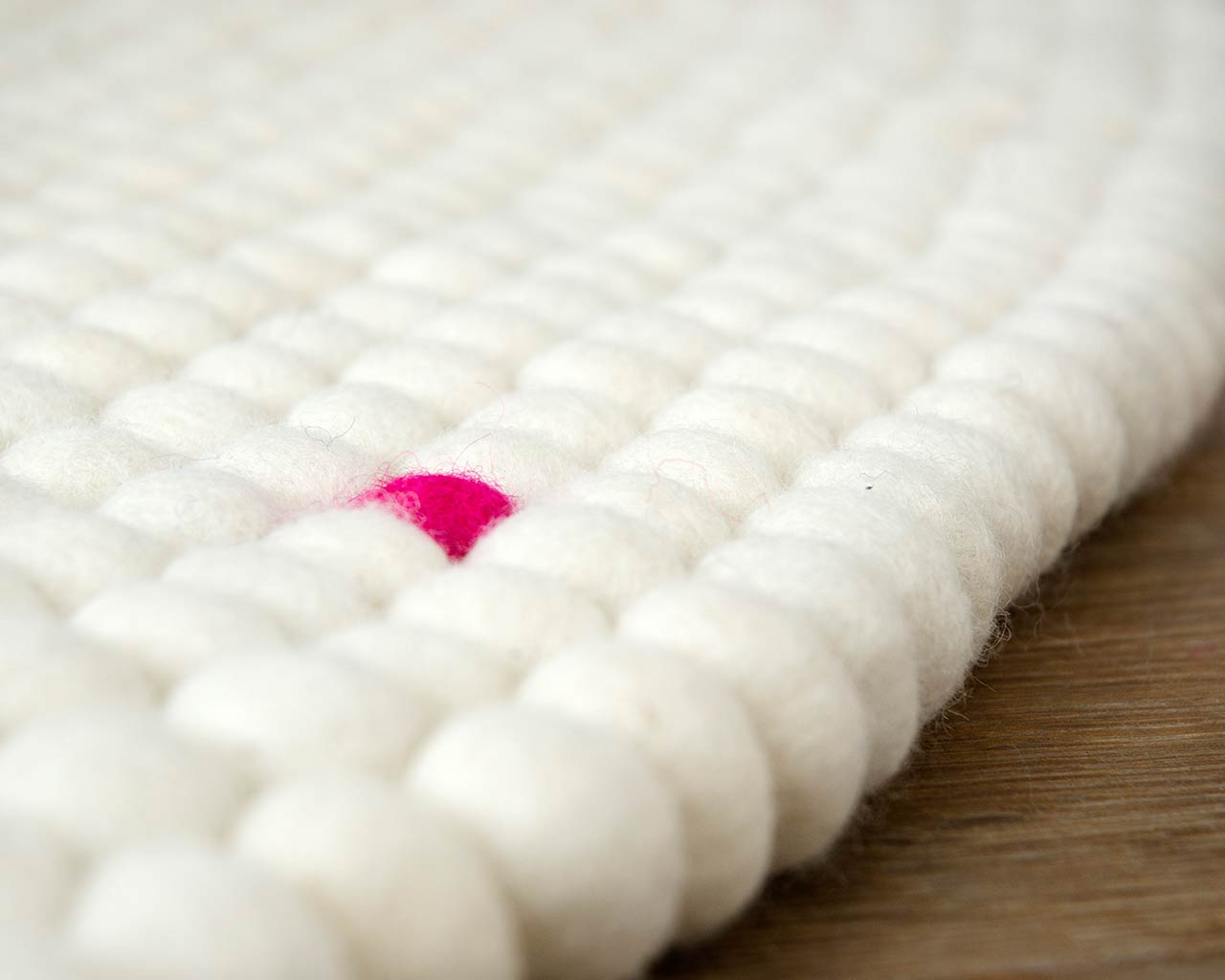 white felt ball rug custom element