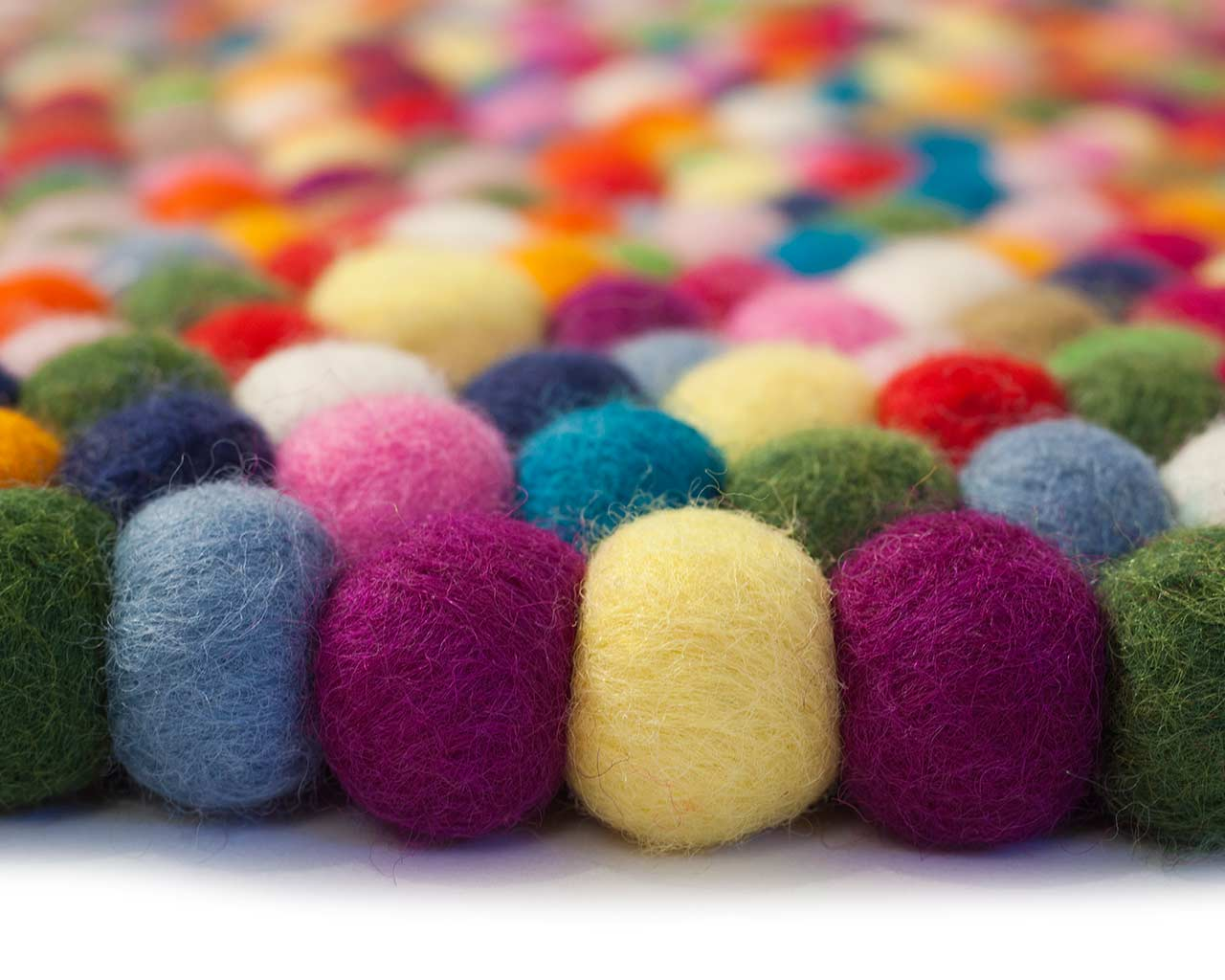balls in colours purple yellow pink blue